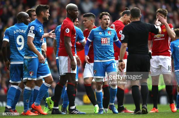Adam Smith of AFC Bournemouth argues with referee Kevin Friend during the Premier League match between Manchester United and AFC Bournemouth at Old...