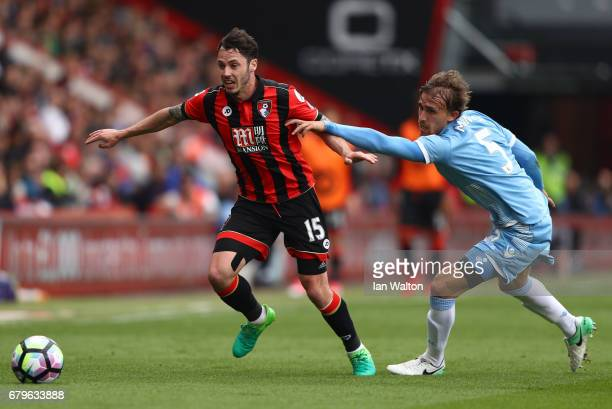 Adam Smith of AFC Bournemouth attempts to get away from Marc Muniesa of Stoke City during the Premier League match between AFC Bournemouth and Stoke...
