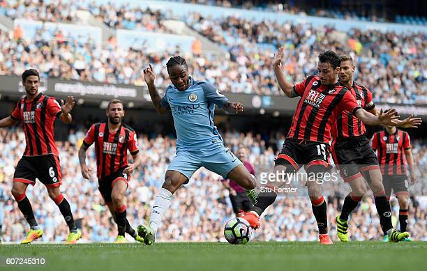 Adam Smith of AFC Bournemouth attempts to stop Raheem Sterling of Manchester City from scoring during the Premier League match between Manchester...