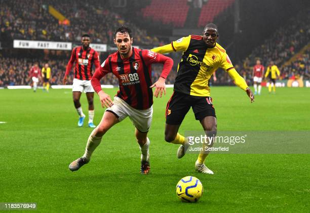 Adam Smith of AFC Bournemouth battles for possession with Abdoulaye Doucoure of Watford during the Premier League match between Watford FC and AFC...