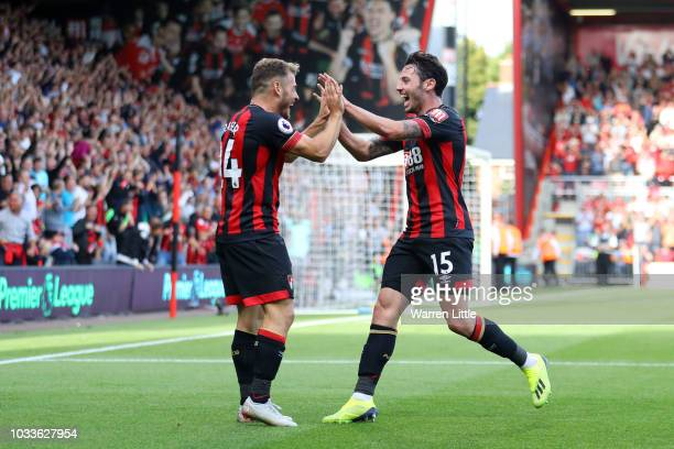 Adam Smith of AFC Bournemouth celebrates after scoring his team's fourth goal with Ryan Fraser of AFC Bournemouth during the Premier League match...