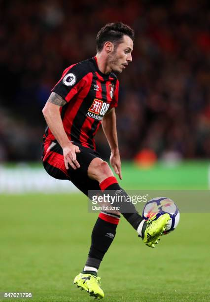 Adam Smith of AFC Bournemouth controls the ball during the Premier League match between AFC Bournemouth and Brighton and Hove Albion at Vitality...