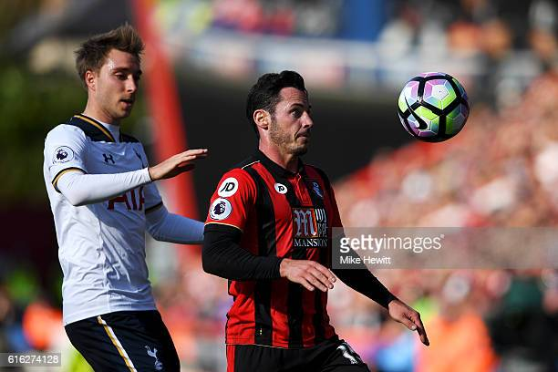 Adam Smith of AFC Bournemouth controls the ball while under pressure from Christian Eriksen of Tottenham Hotspur during the Premier League match...