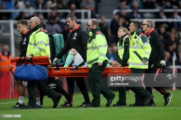 Adam Smith of AFC Bournemouth is carried off the pitch on a stretcher during the Premier League match between Newcastle United and AFC Bournemouth at...
