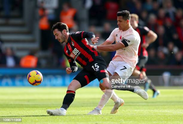 Adam Smith of AFC Bournemouth is challenged by Alexis Sanchez of Manchester United during the Premier League match between AFC Bournemouth and...
