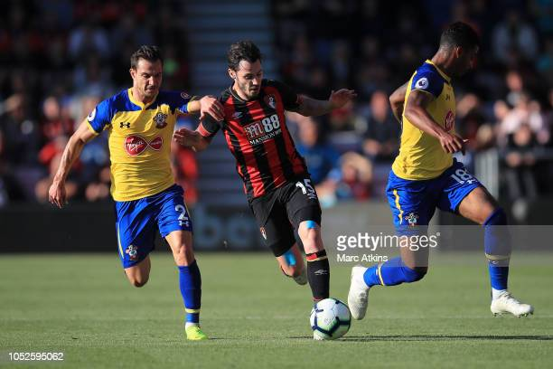 Adam Smith of AFC Bournemouth is challenged by Cedric Soares of Southampton and Mario Lemina of Southampton during the Premier League match between...