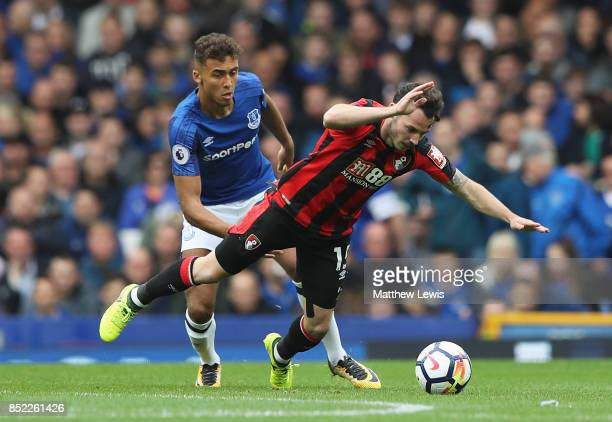 Adam Smith of AFC Bournemouth is challenged by Dominic CalvertLewin of Everton during the Premier League match between Everton and AFC Bournemouth at...