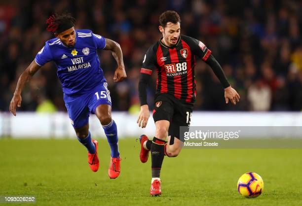Adam Smith of AFC Bournemouth is challenged by Leandro Bacuna of Cardiff City during the Premier League match between Cardiff City and AFC...