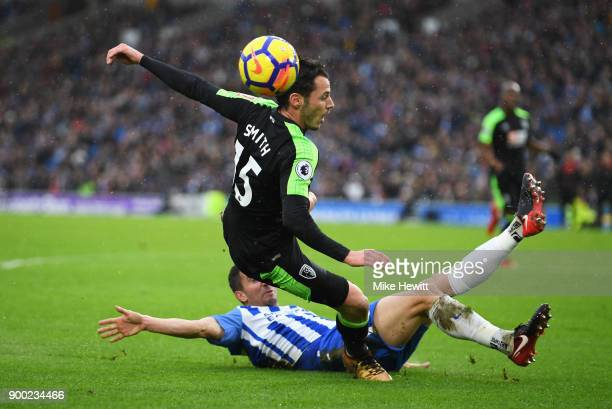 Adam Smith of AFC Bournemouth is challenged by Markus Suttner of Brighton and Hove Albion during the Premier League match between Brighton and Hove...