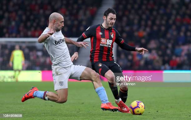 Adam Smith of AFC Bournemouth is challenged by Pablo Zabaleta of West Ham United during the Premier League match between AFC Bournemouth and West Ham...