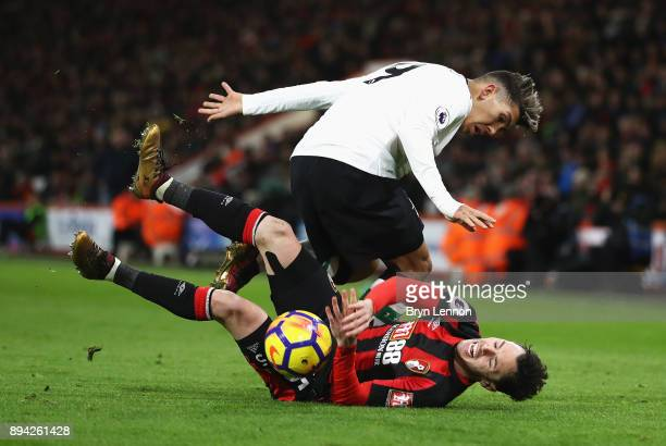 Adam Smith of AFC Bournemouth is challenged by Roberto Firmino of Liverpool during the Premier League match between AFC Bournemouth and Liverpool at...