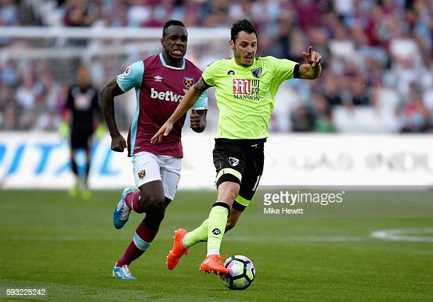 Adam Smith of AFC Bournemouth is closed down by Michail Antonio of West Ham United during the Premier League match between West Ham United and AFC...