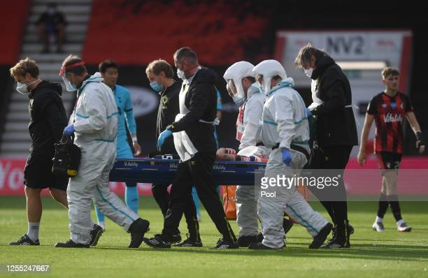 Adam Smith of AFC Bournemouth is stretchered off injured during the Premier League match between AFC Bournemouth and Tottenham Hotspur at Vitality...