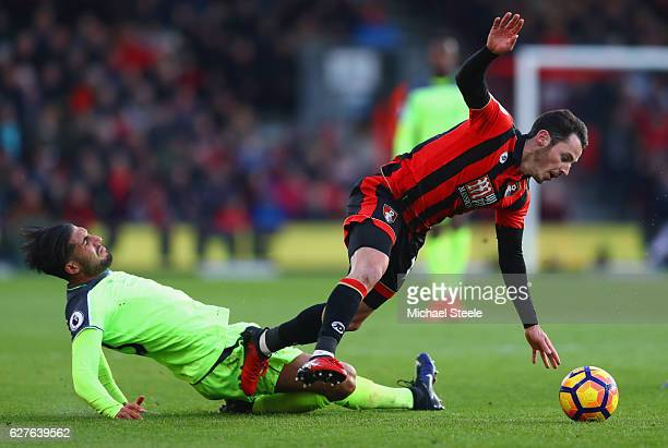 Adam Smith of AFC Bournemouth is tackled by Emre Can of Liverpool during the Premier League match between AFC Bournemouth and Liverpool at Vitality...