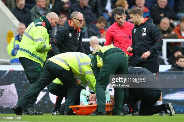Adam Smith of AFC Bournemouth receives medical treatment during the Premier League match between Newcastle United and AFC Bournemouth at St James...