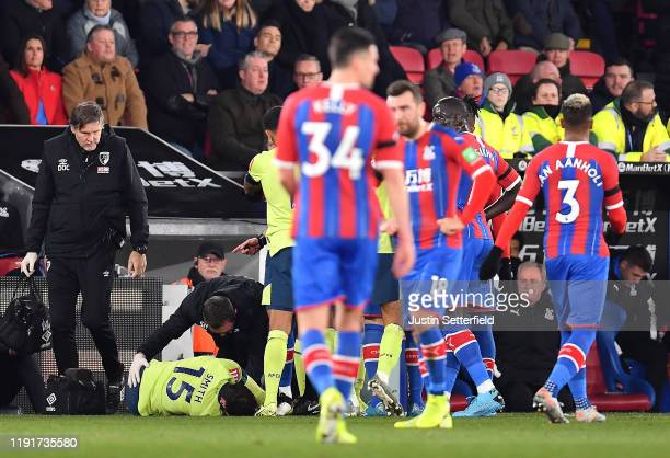 Adam Smith of AFC Bournemouth recieves treatment after a challenge by Mamadou Sakho of Crystal Palace which leads to him being shown the red card by...