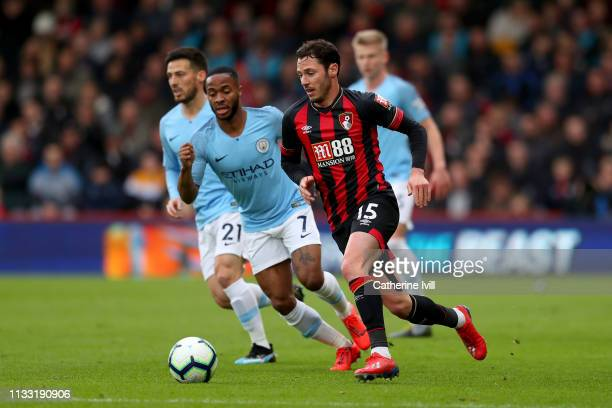 Adam Smith of AFC Bournemouth runs with the ball during the Premier League match between AFC Bournemouth and Manchester City at Vitality Stadium on...