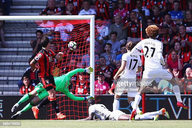 Adam Smith of AFC Bournemouth scores his team's opening goal during the Premier League match between AFC Bournemouth and Manchester United at...