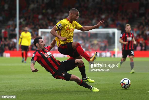 Adam Smith of AFC Bournemouth tackles Richarlison de Andrade of Watford during the Premier League match between AFC Bournemouth and Watford at...