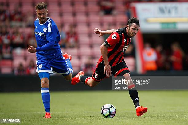 Adam Smith of Bournemouth and Anthony Pilkington of Cardiff City battle for the ball during a preseason match between Bournemouth and Cardiff City at...