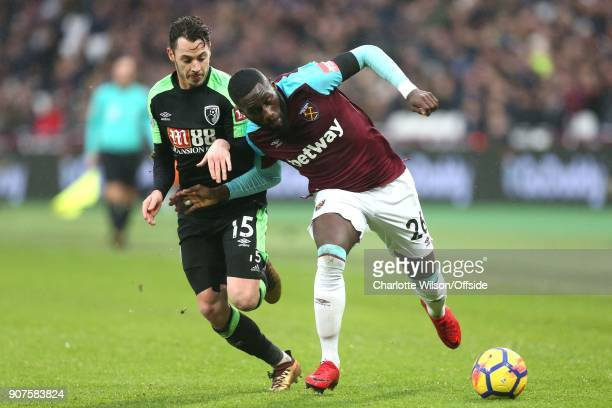 Adam Smith of Bournemouth and Arthur Masuaku of West Ham battle for the ball during the Premier League match between West Ham United and AFC...