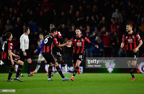 Adam Smith of Bournemouth celebrates scoring his team's first goal with his team mates during the Barclays Premier League match between AFC...