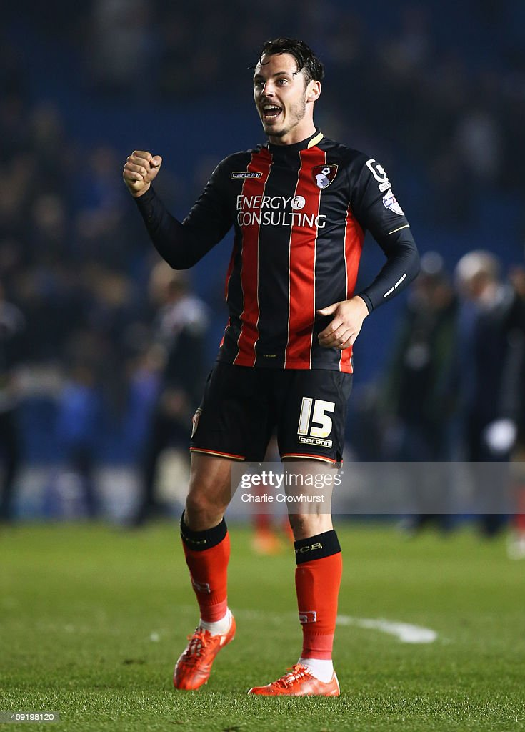 Adam Smith of Bournemouth celebrates victory after the Sky Bet Championship match between Brighton & Hove Albion and AFC Bournemouth at Amex Stadium on April 10, 2015 in Brighton, England.