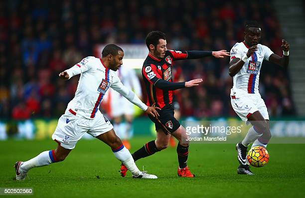 Adam Smith of Bournemouth challenges Pape Souare and Jason Puncheon of Crystal Palace during the Barclays Premier League match between AFC...