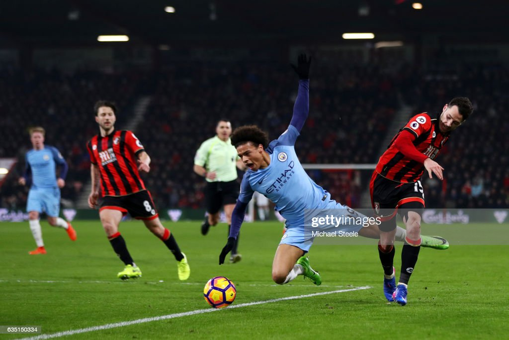 Adam Smith of Bournemouth fouls Leroy Sane of Manchester during the Premier League match between AFC Bournemouth and Manchester City at Vitality Stadium on February 13, 2017 in Bournemouth, England.