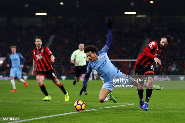 Adam Smith of Bournemouth fouls Leroy Sane of Manchester during the Premier League match between AFC Bournemouth and Manchester City at Vitality...