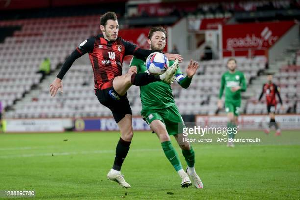 Adam Smith of Bournemouth goes down in the box following a challenge by Alan Browne of Preston North end but his appeal for a penalty is waived away...