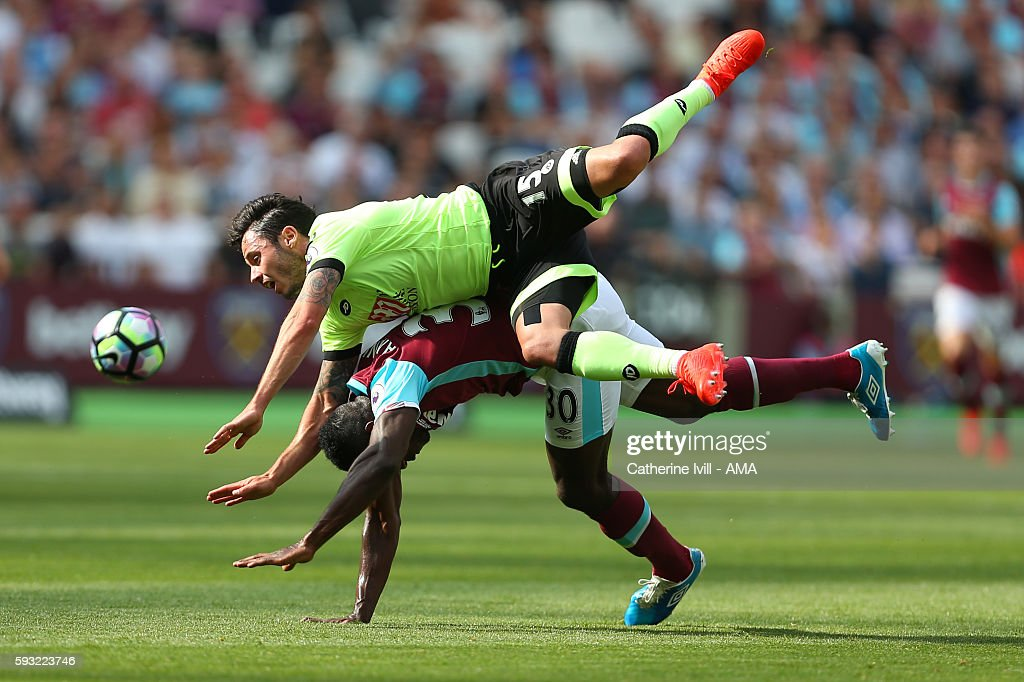 Adam Smith of Bournemouth goes over the top of Michail Antonio of West Ham during the Premier League match between West Ham United and AFC Bournemouth at Olympic Stadium on August 21, 2016 in London, England.