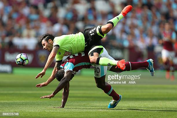 Adam Smith of Bournemouth goes over the top of Michail Antonio of West Ham during the Premier League match between West Ham United and AFC...