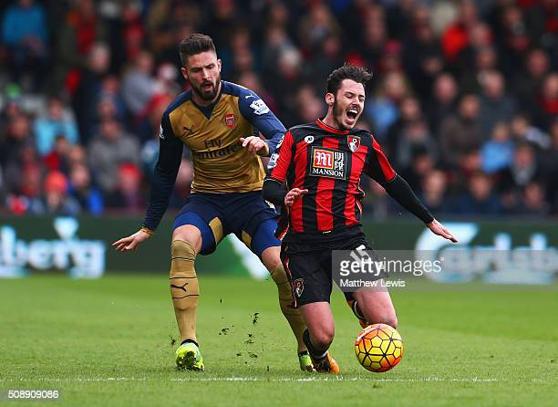 Adam Smith of Bournemouth is challenged by Olivier Giroud of Arsenal during the Barclays Premier League match between AFC Bournemouth and Arsenal at...