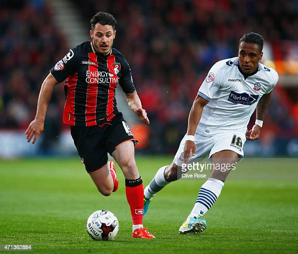Adam Smith of Bournemouth is chased by Neil Danns of Bolton Wanderers during the Sky Bet Championship match between AFC Bournemouth and Bolton...