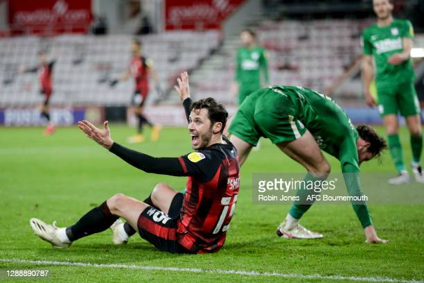Adam Smith of Bournemouth reacts following a challenge by Alan Browne of Preston North end but his appeal for a penalty is waived away during the Sky...