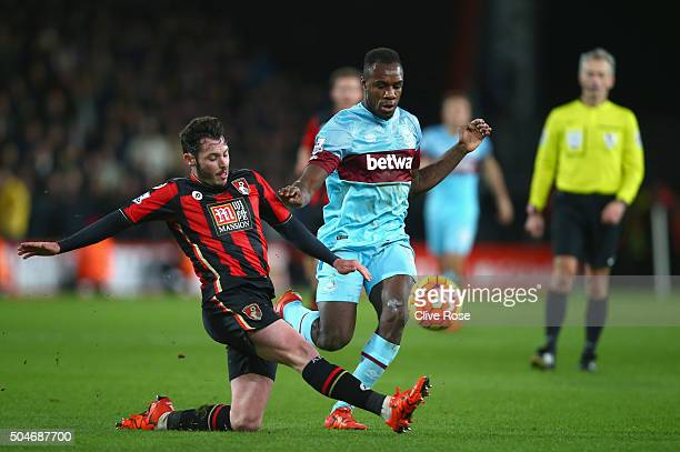 Adam Smith of Bournemouth tackles Michail Antonio of West Ham United during the Barclays Premier League match between AFC Bournemouth and West Ham...