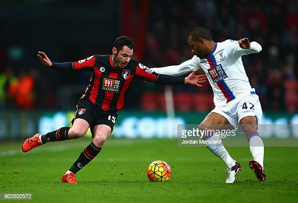 Adam Smith of Bournemouth takes on Jason Puncheon of Crystal Palace during the Barclays Premier League match between AFC Bournemouth and Crystal...