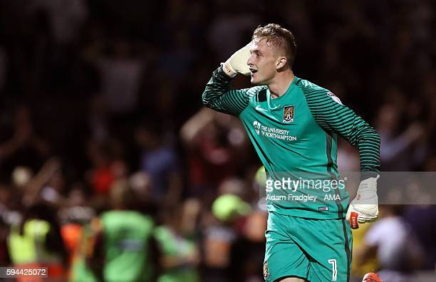 Adam Smith of Northampton Town celebrates after beating West Bromwich Albion on penalties 43 during the EFL Cup fixture between Northampton Town and...