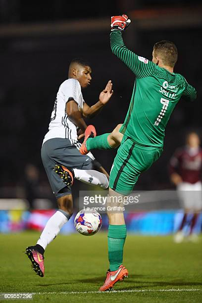 Adam Smith of Northampton Town makes a mistake as Marcus Rashford of Manchester United capitalises to score his sides third goal during the EFL Cup...