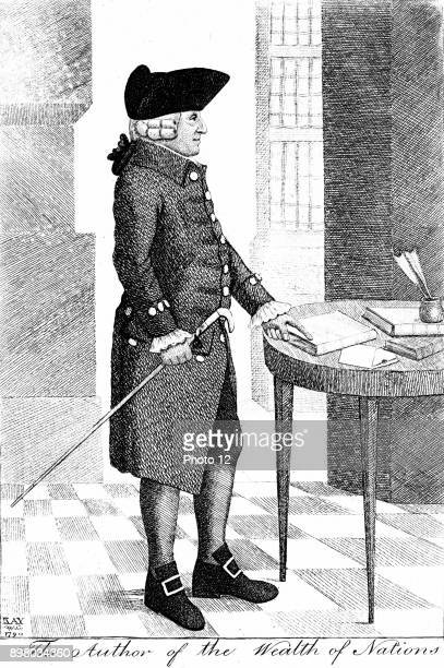 Adam Smith Scottish philosopher and economist standing wearing hat and wig and carrying cane pointing to book on table Author of Inquiry into the...