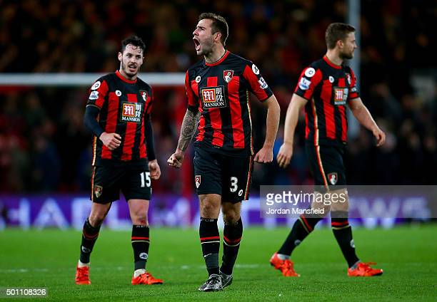 Adam Smith Steve Cook and Simon Francis of Bournemouth celebrate their team's 21 win in the Barclays Premier League match between AFC Bournemouth and...