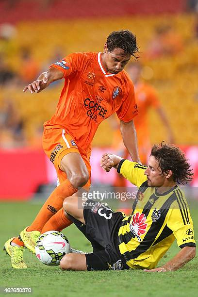 Adam Sorota of the Roar and Albert Riera of the Phoenix compete for the ball during the round 16 ALeague match between the Brisbane Roar and the...