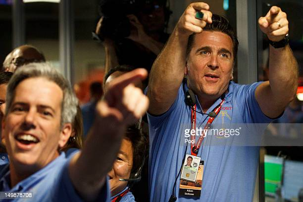 Adam Steltzner, right, celebrates a successful landing inside the Spaceflight Operations Facility for NASA's Mars Science Laboratory Curiosity rover...