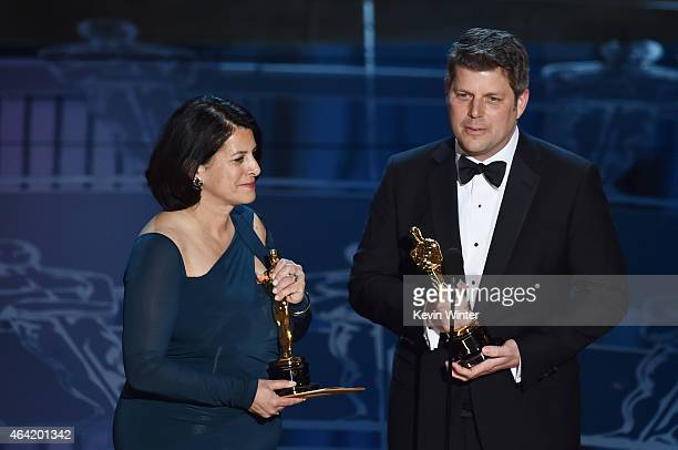 Adam Stockhausen and Anna Pinnock accept the Best Production Design Award for The Grand Budapest Hotel onstage during the 87th Annual Academy Awards...