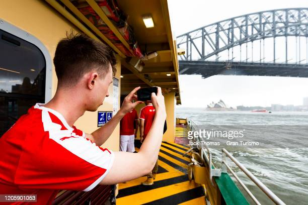 Adam Suswillo of Great Britain takes a photo of the Sydney Harbour Bridge prior to Round 1 of the Gran Turismo World Tour 2020 at Luna Park on...