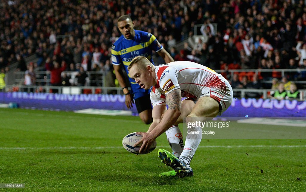 Adam Swift of St Helens scores first half try during the First Utility Super League match between St Helens and Warrington Wolves at Langtree Park on March 19, 2015 in St Helens, England.