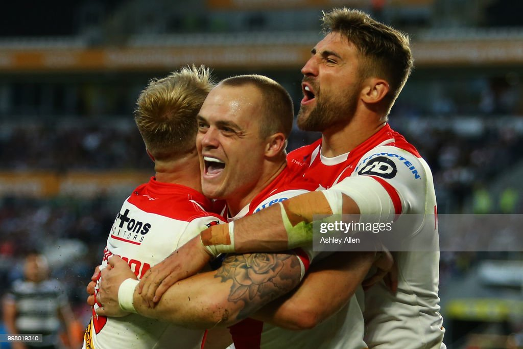 Adam Swift (C), Tommy Makinson (R) and Danny Richardson (L) of St Helens celebrate during the BetFred Super League match between Hull FC and St Helens Saints at the KCOM Stadium on July 13, 2018 in Hull, England.