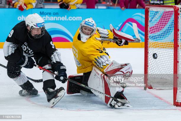 Adam Sykora vies with Goalkeeper Loris Uberti during Men's Mixed NOC 3-on-3 Preliminary Round Games of the Lausanne 2020 Winter Youth Olympics at...