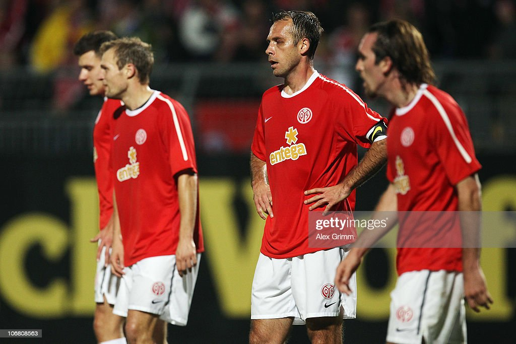 Adam Szalai, Bo Svensson, Nikolce Noveski and Christian Fuchs (L-R) of Mainz react during the Bundesliga match between FSV Mainz 05 and Hannover 96 at the Bruchweg Stadium on November 13, 2010 in Mainz, Germany.